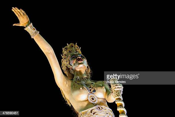 A member of Imperatriz Leopoldinense Samba School gestures during their parade at 2014 Brazilian Carnival at Sapucai Sambadrome on March 03 2014 in...