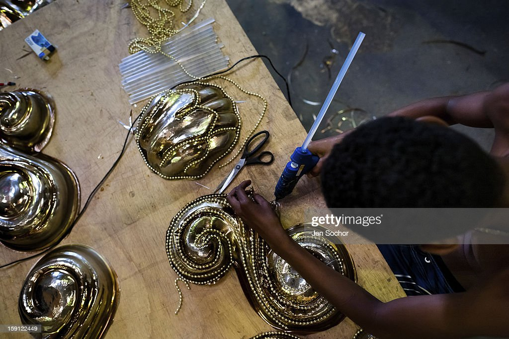 A member of Império Serrano samba school works on a carnival float inside the workshop in Rio de Janeiro, Brazil, 13 February 2012. The carnival preparations start early in July or August, some 7-8 months before the main samba schools parade at the sambodrome. Samba schools hire teams of professional designers and artists who, according to the original theme selected by the school directors and then featured by the school during the parade, create allegorical floats, costumes, sculptures, music, choreography and the entire school show. However, the most of the everyday work in the carnival hangars is performed by unknown but fully dedicated samba schools members.