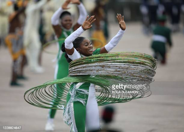 Member of Independence Band performs at the Eagles Square in Abuja, Nigeria during the countrys 60th Independence Celebration on October 1, 2020. -...