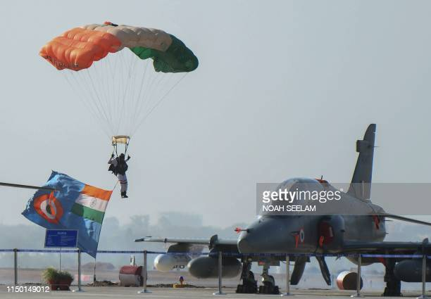 A member of Indian Air Force sky diving team 'Akash Ganga' performs during a combined graduation parade at the Indian Air Force Academy in Hyderabad...