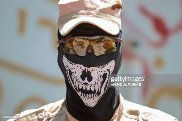A member of Iraq's CounterTerrorism Service poses for a picture in a skeletondefaced skimask as Iraqi forces advance towards the Old City of Mosul on...