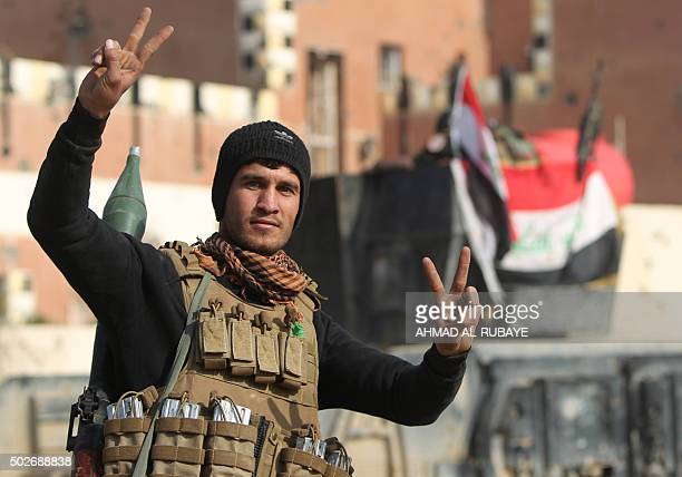 A member of Iraq's elite counterterrorism service flashes the 'V' for victory sign on December 28 2015 after Iraqi forces recaptured the city of...