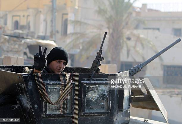 TOPSHOT A member of Iraq's elite counterterrorism service flashes the 'V' for victory sign on December 29 2015 in the city of Ramadi the capital of...
