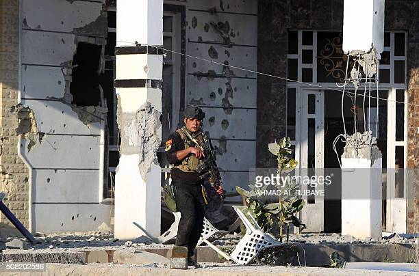 A member of Iraq's elite counterterrorism service patrols a suburb in the alSajariyah area east of the city of Ramadi the capital of Iraq's Anbar...
