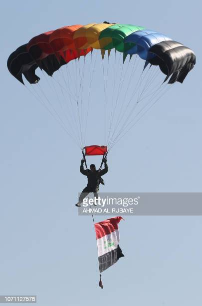 A member of Iraq's Rapid Response military shows his skills during a ceremony at a military base inside Baghdad's International Airport to mark the...