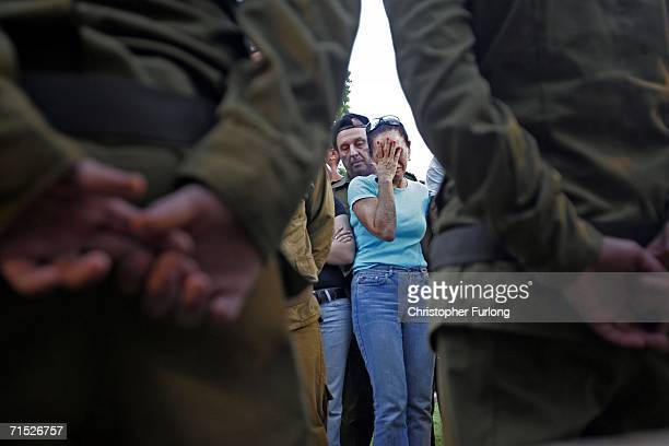 A member of Israeli paratrooper Yiftach Shrayer's family grieves at his graveside during the twenty one year old's funeral in a cemetery on July 27...
