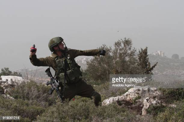 A member of Israeli security forces throws a tear gas can during Palestinians' protest against US President Donald Trumps announcement to recognize...