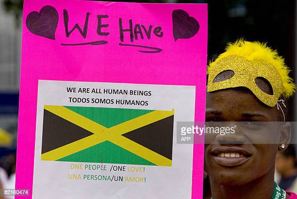 A member of Jamaica's gay community takes part in the first international march against stigma discrimination and homophobia in Mexico City on August...