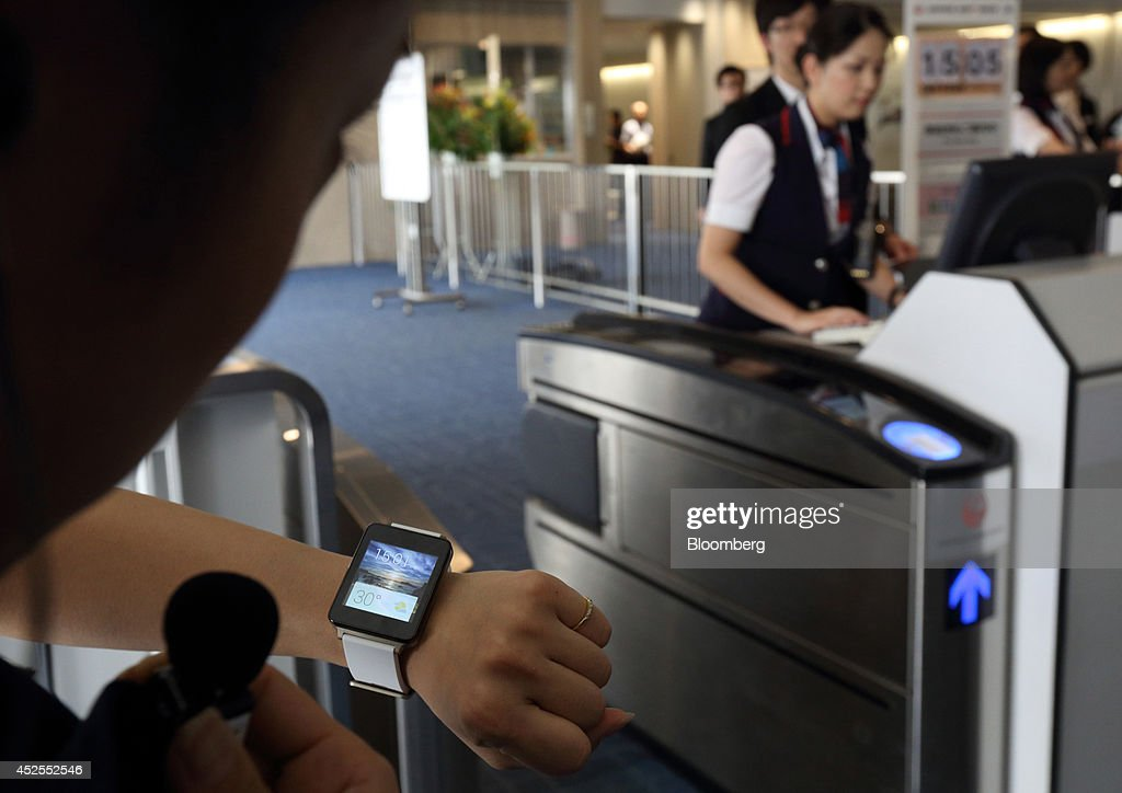 Japan Airlines Co. Trials Smartwatch Use For Passenger Service At Haneda Airport : News Photo