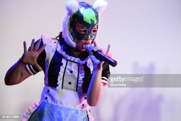 A member of Japanese pop group 'Virtual Currency Girls' performs onstage in Tokyo Japan on Friday Feb 16 2018 The eightmember girl group held a...
