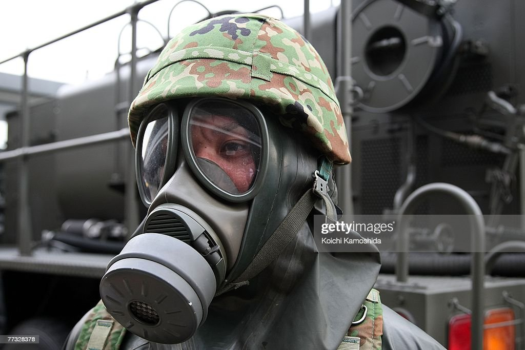 A member of Japan's Self-Defence Force exercise the removal of unidentified chemical substances with an anti-chemical suit during the Proliferation Security Initiative (PSI) Maritime Interdiction Exercise 'Pacific Shield 07', at Yokohama Port on October 15, 2007 in Kanagawa, Japan. Australia, France, New Zealand, Singapore, the U.K. and the U.S. will also participate in the Exercise. PSI is an international effort to halt the proliferation of weapons of mass destruction, missiles and related materials, threat to the peace and stability of the international community.