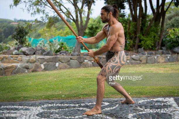 A member of Kaikoura Maori community performs a traditional welcome to Prince Charles Prince of Wales at Takahanga Marae in Kaikoura on November 23...