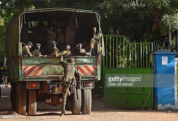 A member of Kenya Defence Forces boards a truck carrying Kenyan Police as it enters the university campus of the northeastern town of Garissa on...