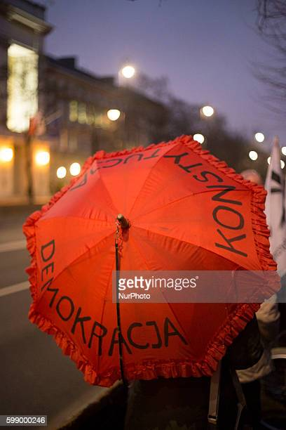 Member of KOD holds umbrella with written quotDemocracy and constitutionquot during antigovernment demonstration in Warsaw on March 10 2016