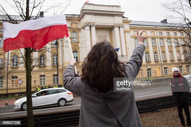 Member of KOD near government building during antigovernment demonstration in Warsaw on March 10 2016