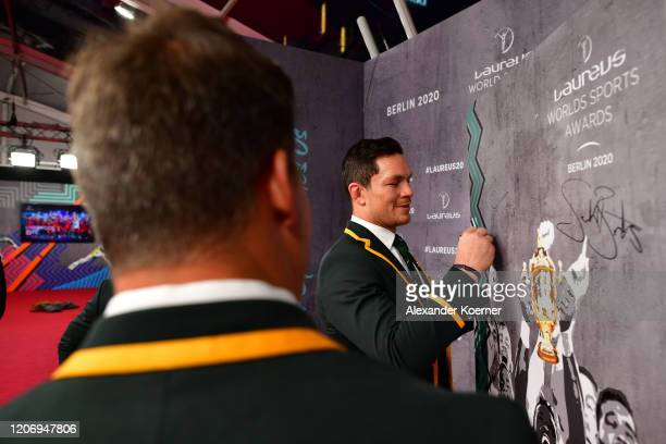Member of Laureus World Team of the Year the South Africa Men's Rugby Team Francois Louw signs a wall during the 2020 Laureus World Sports Awards at...
