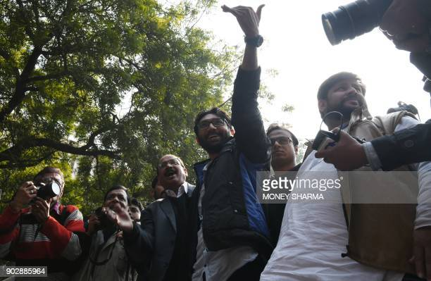 Member of legislative assembly from Gujarat and social activists Jignesh Mevani waves to the crowd during a rally in New Delhi on January 9 2018 The...