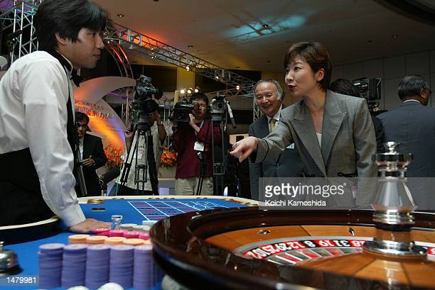 A member of Liberal Democratic Party Seiko Noda plays roulette at the metropolitan government office building October 17 2002 in Tokyo Japan Tokyo...