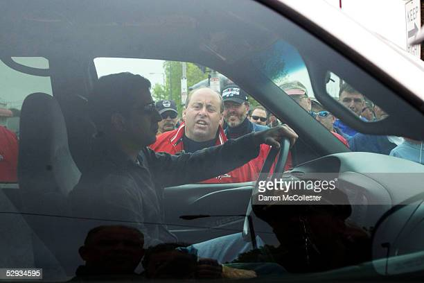 A member of Local 369 of the Utility Workers Union of America yells at a man crossing a picket line outside Nstar offices May 18 2005 in Dorchester...