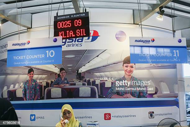 A member of Malaysia Airlines staff works at ticket counter inside the Kuala Lumpur International Airport on June 2 2015 in Sepang Malaysia Chief...