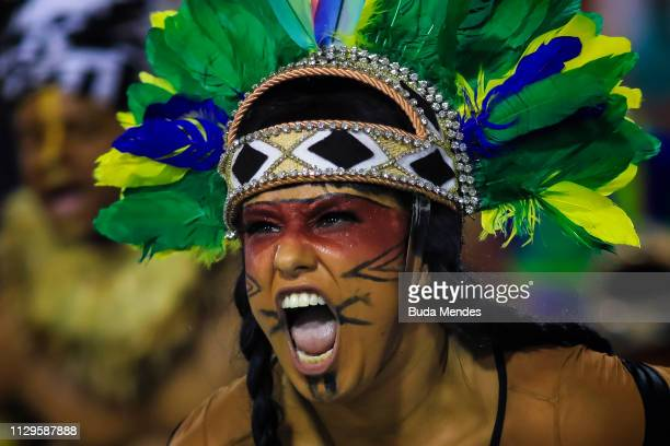 A member of Mangueira performs during the samba school's champions parade at Sapucai Sambadrome on March 10 2019 in Rio de Janeiro Brazil Carnival is...