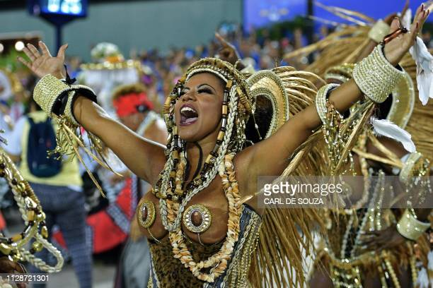 A member of Mangueira samba school performs during the second night of Rio's Carnival parade at the Sambadrome in Rio de Janeiro Brazil on March 5...