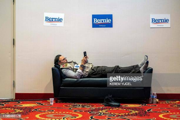 Member of media of democratic presidential candidate Vermont Senator Bernie Sanders waits for results to come in at his caucus night watch party on...