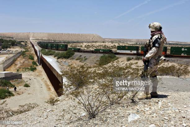 Member of Mexican National Guard watches the border with the US at the Anapra area in Ciudad Juarez, State of Chihuahua, Mexico, on June 26, 2019. -...