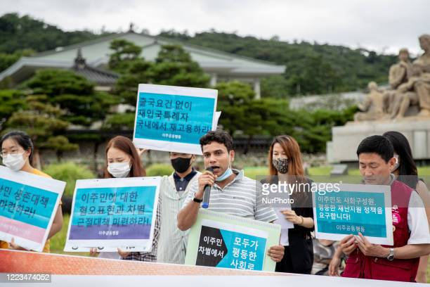 Member of migrant workers and migrant human rights groups gather for a joint press conference at in front of the presidential house, Cheong Wa Dae on...