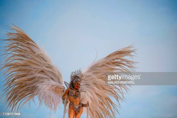 TOPSHOT A member of Mocidade Independente de Padre Miguel samba school performs during the second night of Rio's Carnival parade at the Sambadrome in...