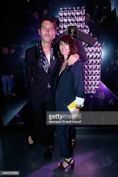 Member of Musical Group Aaron Simon Buret and Mademoiselle Agnes Boulard attend YSL Beauty launches the new Fragrance 'Mon Paris' at Cafe Le Georges...