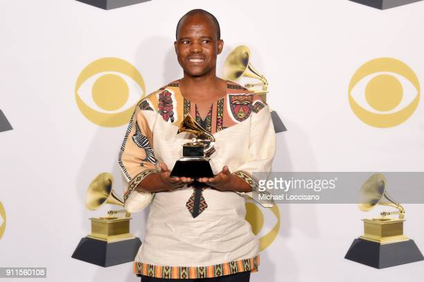 A member of musical group Ladysmith Black Mambazo winners of Best World Music Album for 'Shaka Zulu Revisited 30th Anniversary Celebration' poses in...