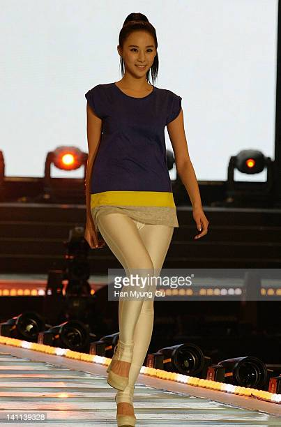 Member of Nine Muses showcases a design by Eight Seconds at the KPOP Fashion Concert on March 11 2012 in Seoul South Korea