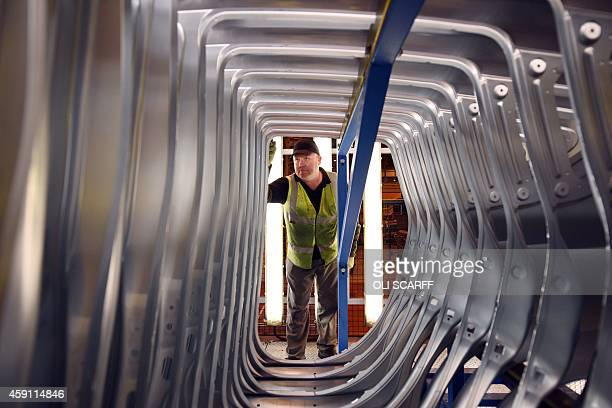 A member of Nissan's manufacturing staff inspects vehicle body panels in the Press Shop at the Sunderland Plant in North East England on November 12...