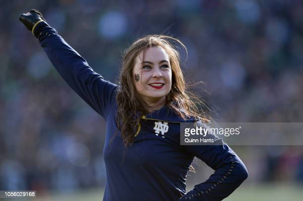 A member of Notre Dame Fighting Irish cheerleading team cheers during the game against the Notre Dame Fighting Irish at Notre Dame Stadium on October...
