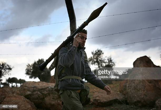 A member of Opponent Aleppo Brigades is seen before he attacks Assad regime forces in Melah region on the north side of Aleppo Syria on February 17...