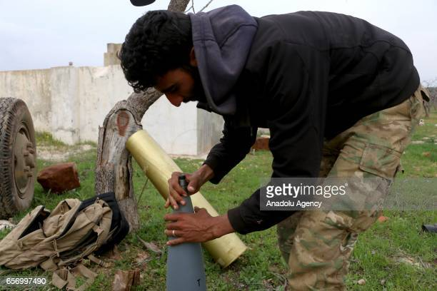 A member of opposition groups makes preparations before they attack to Assad Regime Forces as they advance to Hama in Syria on March 23 2017