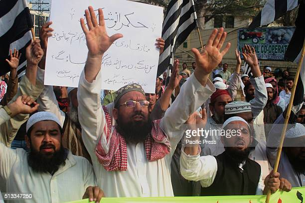 A member of Pakistani Islamists shouts slogans during a protest in Lahore against the execution of convicted murderer Mumtaz Qadri Adyala Jail hanged...