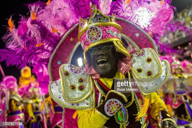 A member of Paraiso do Tuiuti samba school smiles during the first night of 2020 Rio's Carnival Parades at the Sapucai Sambadrome on February 23 2020...