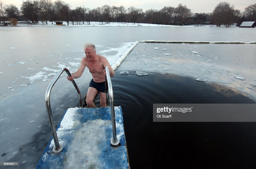 Member of Parliament Edward Leigh swims in a hole in the ice made in the Serpentine lake in Hyde Park on January 8, 2009 in London, England. Extremely cold conditions are continuing to grip the UK with many overnight temperatures falling to -10 degrees Celsius and the Scotish village of Sutherland recording -22C..