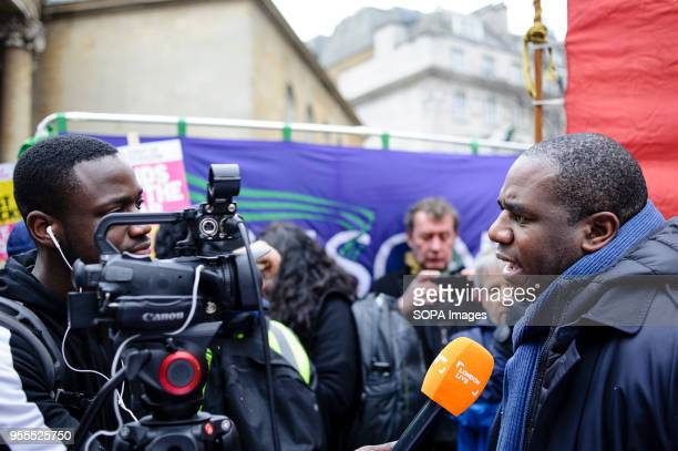 Member of Parliament for Tottenham David Lammy gives an interview to television channel London Live on Portland Place in freezing conditions ahead of...