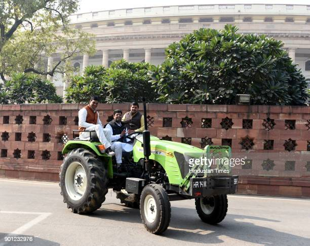 Member of Parliament from Hisar Lok Sabha Constituency Dushyant Chautala leaves on his tractor after attending the Parliament Winter Session on...