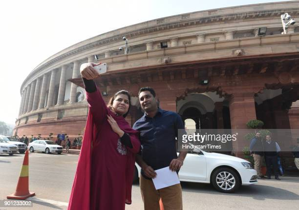 Member of Parliament from Mumbai North Central Poonam Mahajan takes a selife with her friend during the Parliament Winter Session on January 4 2018...