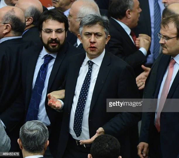 Member of parliament from the main opposition Republican People's Party Ali Ihsan Kokturk's nose bleeds as MPs from the ruling AK Party and CHP...