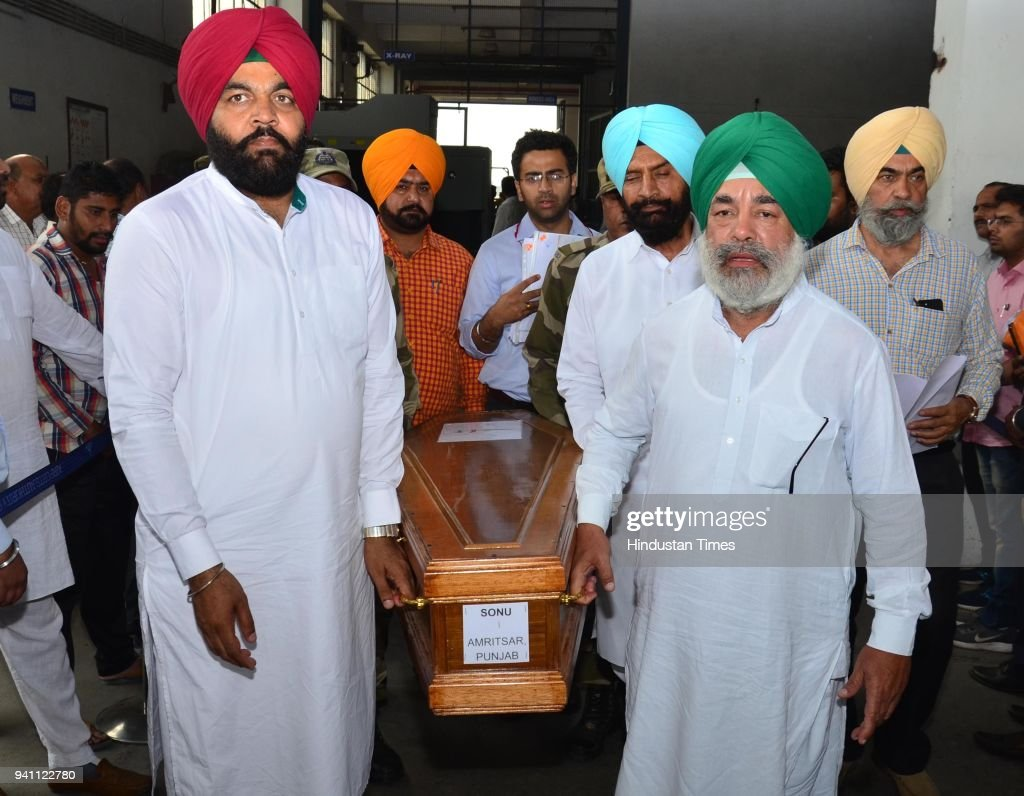 Member of Parliament Gurjeet Singh Aujla and other Congress Leaders carrying the Coffin of Sonu which was brought from Iraq at Sri Guru Ram Dass Jee..