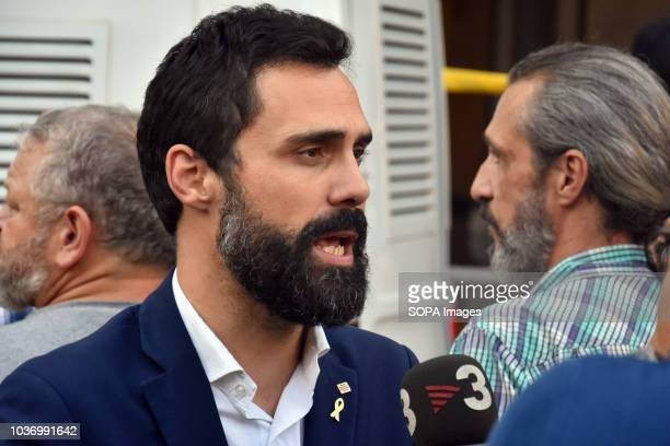 Member of parliament seen speaking to the media during protests in support of Catalonia's independence and commemorate the first anniversary of the...