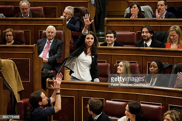 Member of Podemos party Irene Montero rises her hand as she takes her seat as deputy during the inaugural meeting of the eleventh legislature of the...