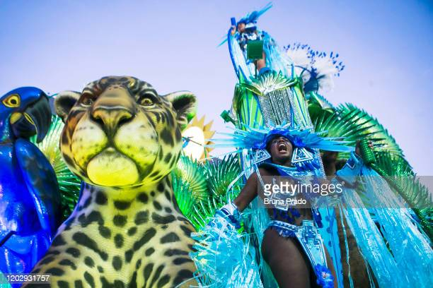 A member of Portela samba school perform on top of a float during the first night of 2020 Rio's Carnival Parades at the Sapucai Sambadrome on...