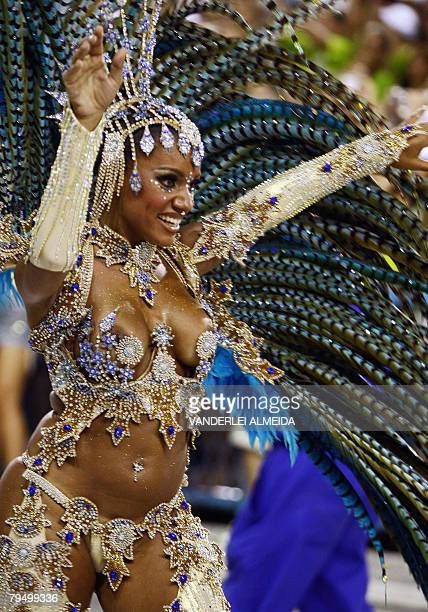 A member of Portela samba school performs at the Sambodrome during the first night of carnival celebrations in Rio de Janeiro Brazil on February 4...