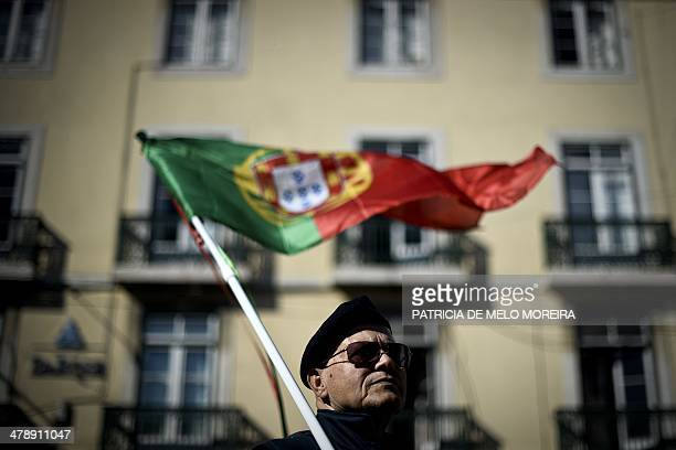 A member of Portugal's armed forces takes part in a demonstration against the government's austerity measures and budget cuts in Lisbon on March 15...